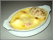 Boiled eggs in a creamy cheese sauce